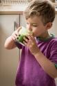 Toddler drinking green smoothie